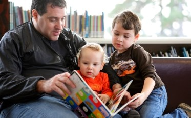 Father & sons reading