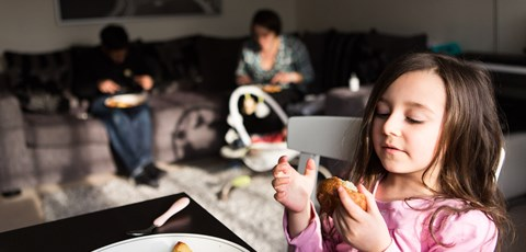 Family eating in lounge