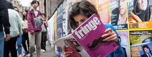 Woman looking at Fringe brochure