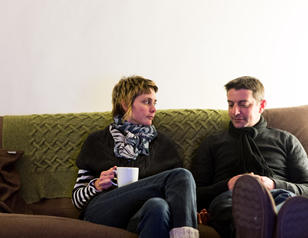 Couple sitting on sofa 2 HOME